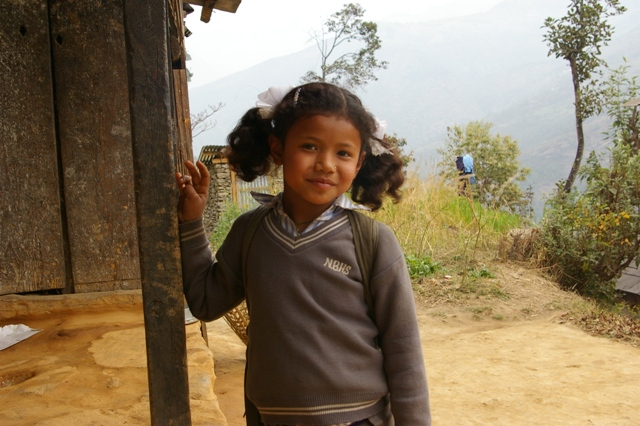 A girl going to Niko Bhumi School with a toilet newly built with support from ETC
