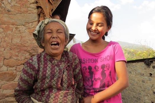 Scholar, Anju Theeng smiles with her grandmother knowing that she would be able to continue her education