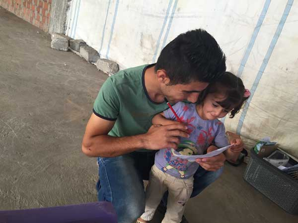 an EDGE volunteer reads with a little girl