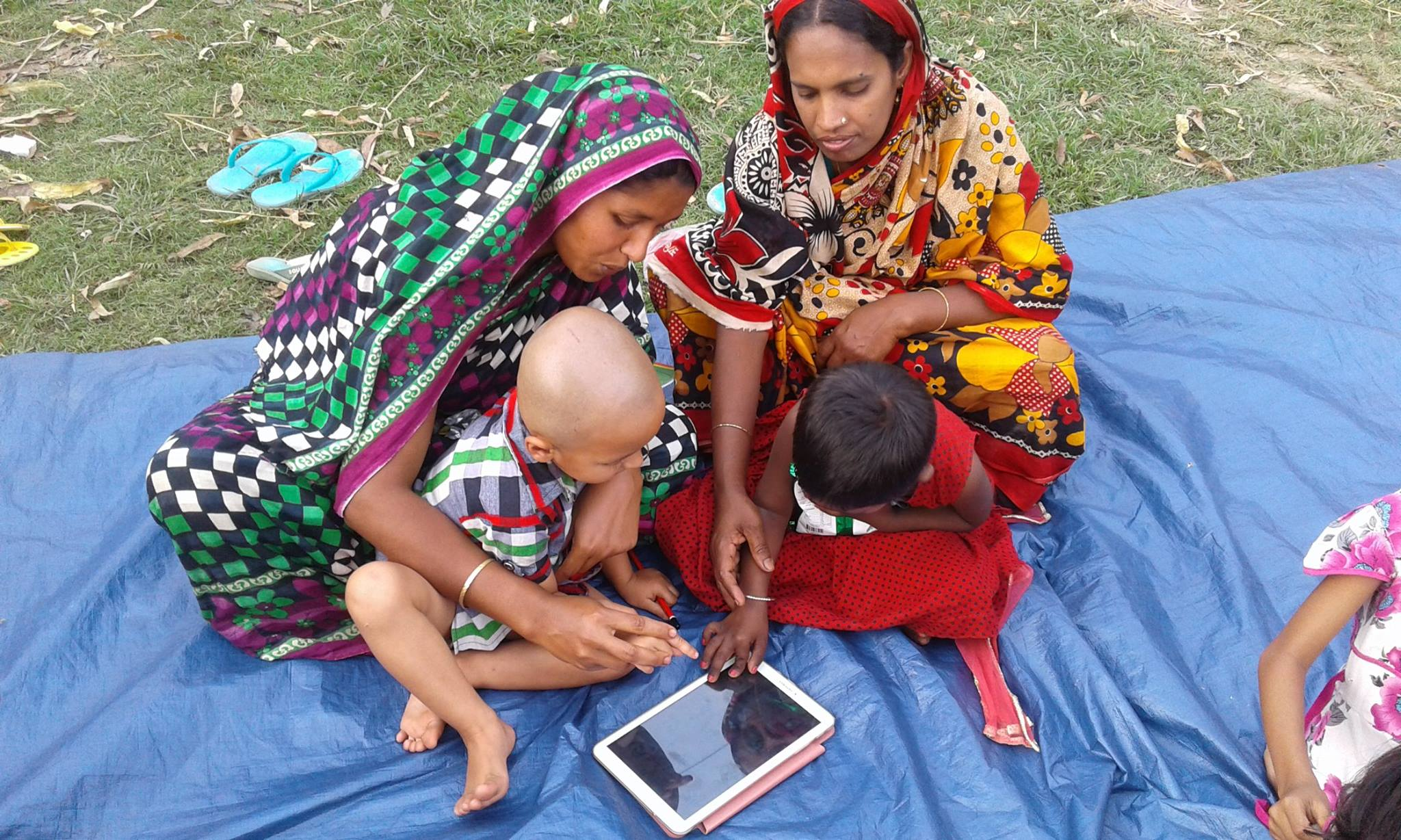 Mothers use tablets with their children