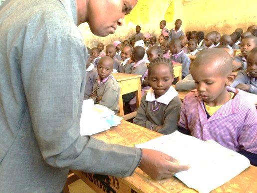 A teacher in a classroom at Kayole Primary School