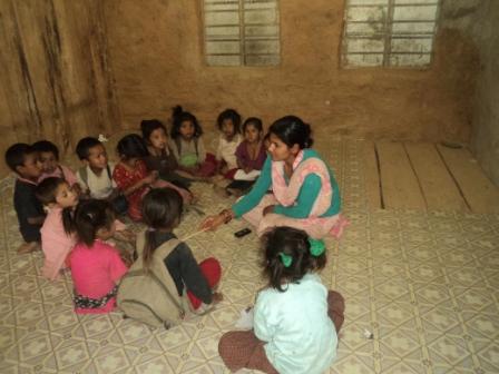 School children sitting with their teacher
