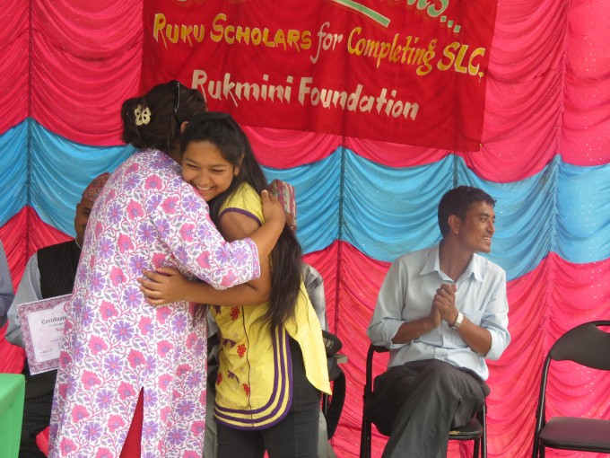 Scholar Sushmita Sunar embraces Pushpa Didi during a Didi Program where we honored recent graduates