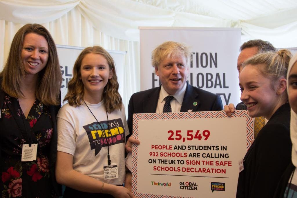 Caption: Boris Johnson, Global Citizen and young campaigners from Send my Friend to School participate in a handover of youth actions calling for Safe Schools