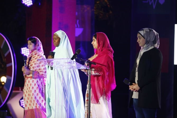 Caption: Malala Yousafzai and young refugee girls advocate for girls' education at he 2015 Global Citizen Festival